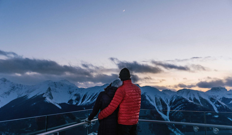 Couple standing on the observation deck at the Banff Gondola