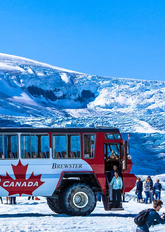 People stepping off the Ice Explorer bus onto the Athabasca Glacier