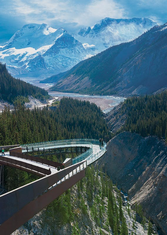 View of the Columbia Icefield Skywalk platform jutting out above valley with glacier views