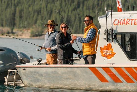 A fishing guide helps an angler learn to fish