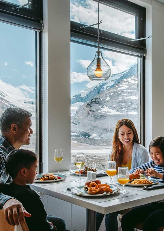 Family dining at Altitude restaurant with glacier views of the Columbia Icefield