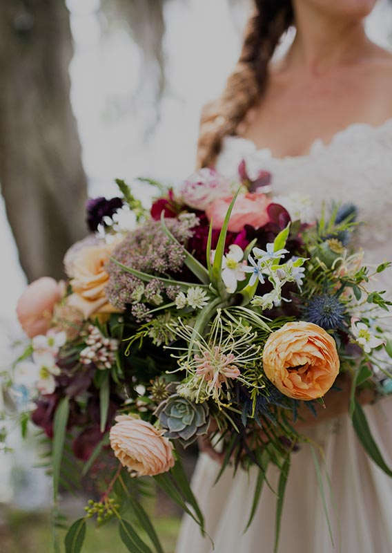 A bride holds a bouquet of flowers