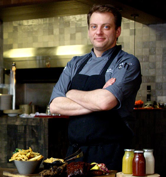 Chef Tim Barath stands in front of restaurant