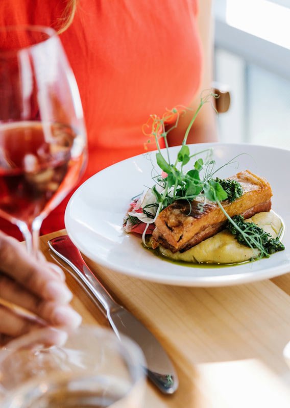 Twice Baked Pork Belly served at Sky Bistro with a glass of wine