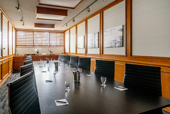 A bright boardroom with a long table for meetings