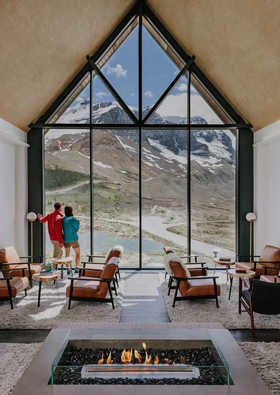The view of the Athabasca Glacier from a high-ceiling lounge.