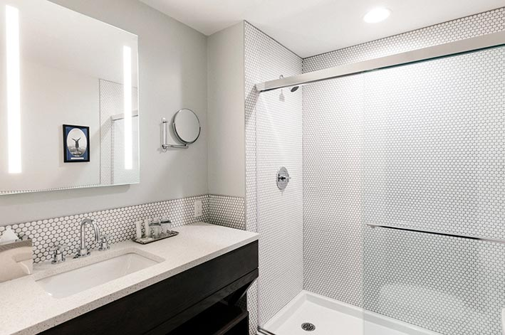 A bathroom sink and shower.