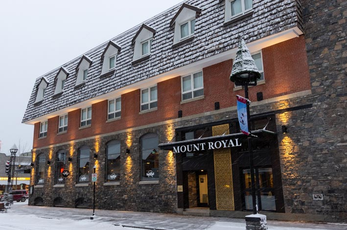 The Mount Royal Hotel and front sidewalk, covered in a dusting of snow