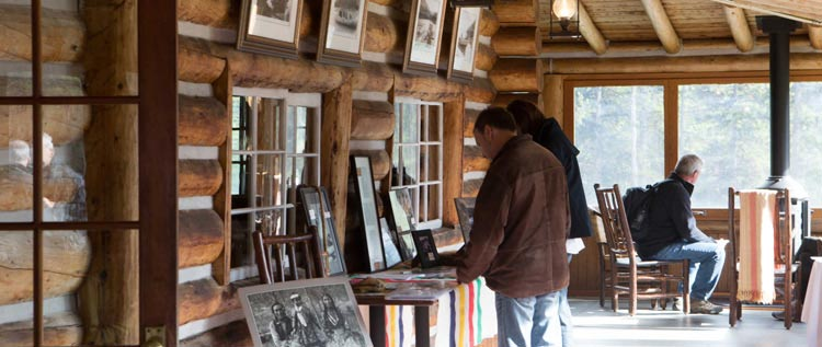 Guests viewing historic artifacts in Maligne Lake Chalet