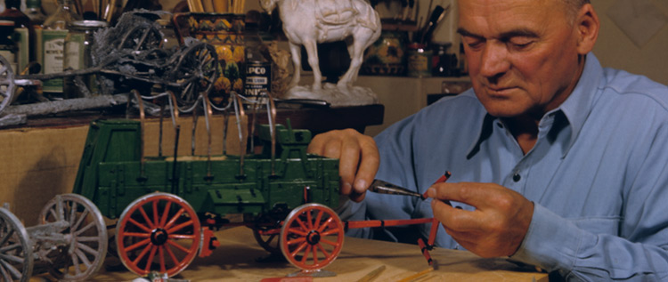 A man tinkers with a machine