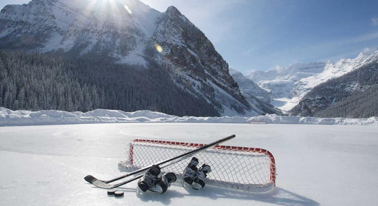 Hockey net and skates on the ice skating rink at Fairmont Chateau Lake Louise