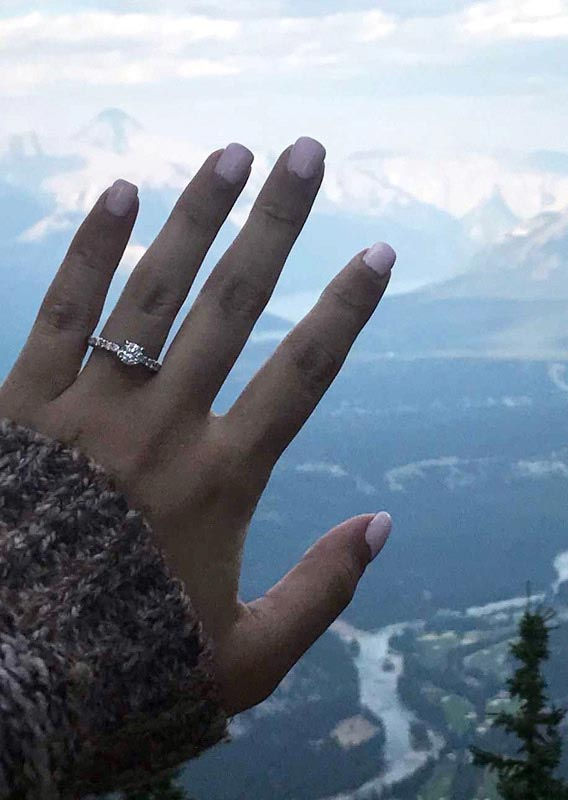 Engagement ring on the hand of Melissa Angarano overlooking the Bow Valley