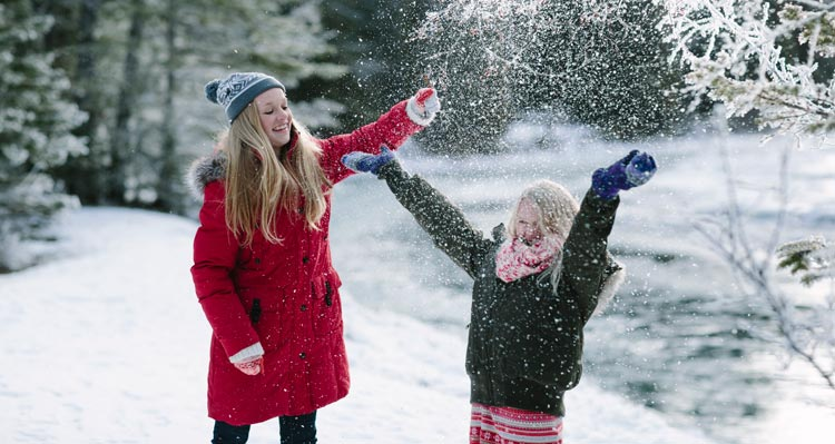 Two children play with powdery snow