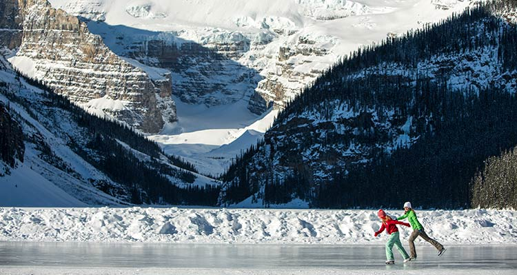 Two ice skaters on frozen Lake Louise