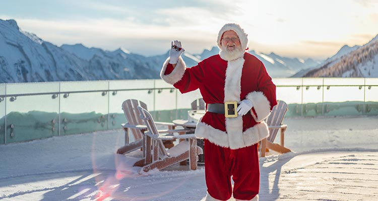 Santa Claus stands on the observation deck of the Banff Gondola