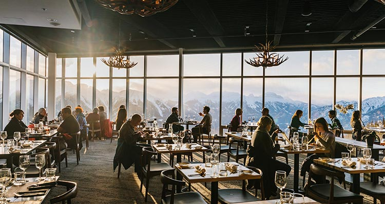 The Sky Bistro dining room overlooking snowy mountain range