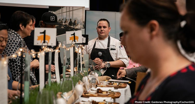 Chef Scott at his table of dishes at Cochon555