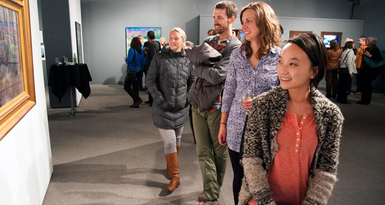 A group of people at an art gallery