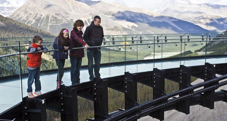 A family looking down from the Columbia Icefield Skywalk