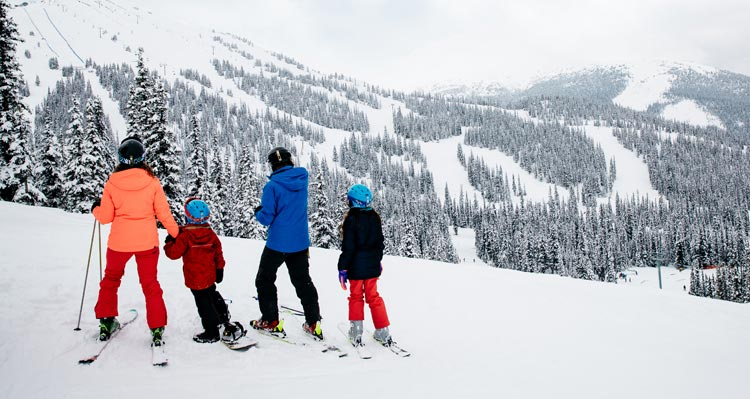 A family gets ready to ski and snowboard at Marmot Basin ski resort