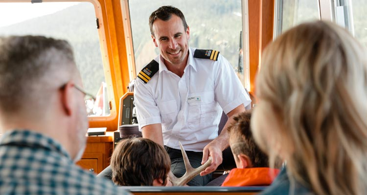 A boat captain talks to visitors.