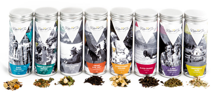 a set of different metal tea canisters