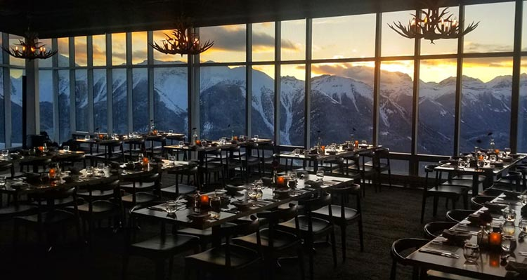 A dining room view overlooking a mountain range.