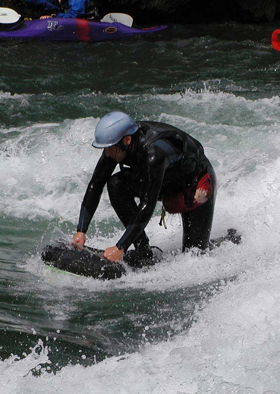 Getting up on a riverboard on the Kananaskis River