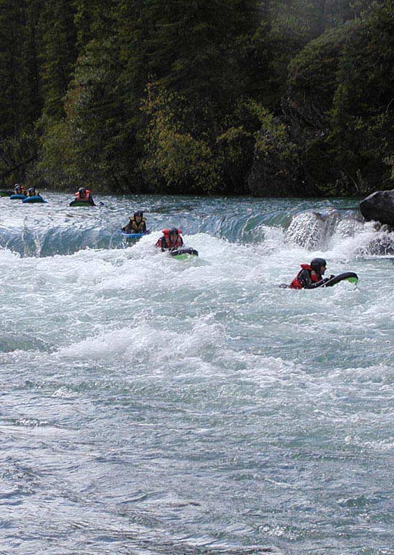 Group of riverboarders on Kananaskis River